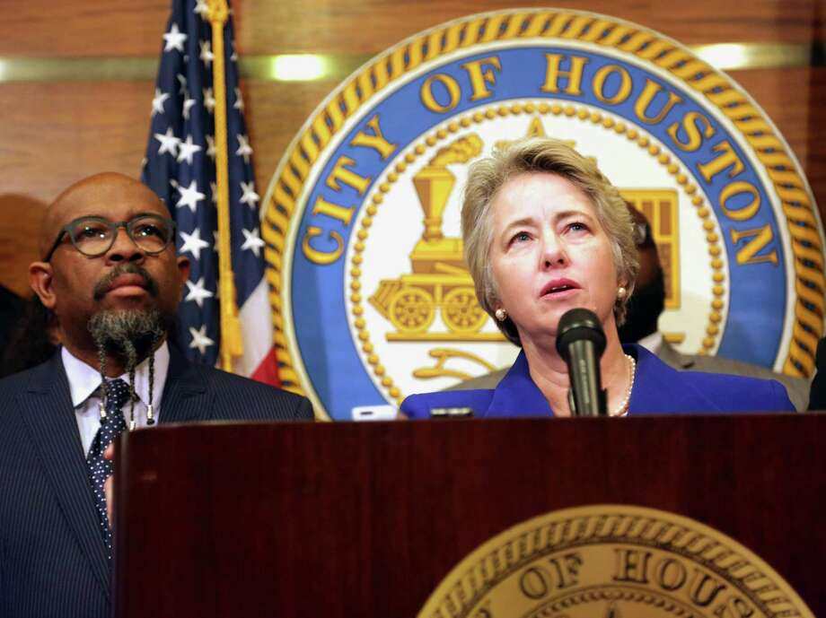 Flanked by clergy, Mayor Annise Parker announces that the city will withdraw subpoenas issued in the suit over Houston's equal rights law. (Billy Smith II / Chronicle) Photo: Billy Smith II, Staff / © 2014 Houston Chronicle