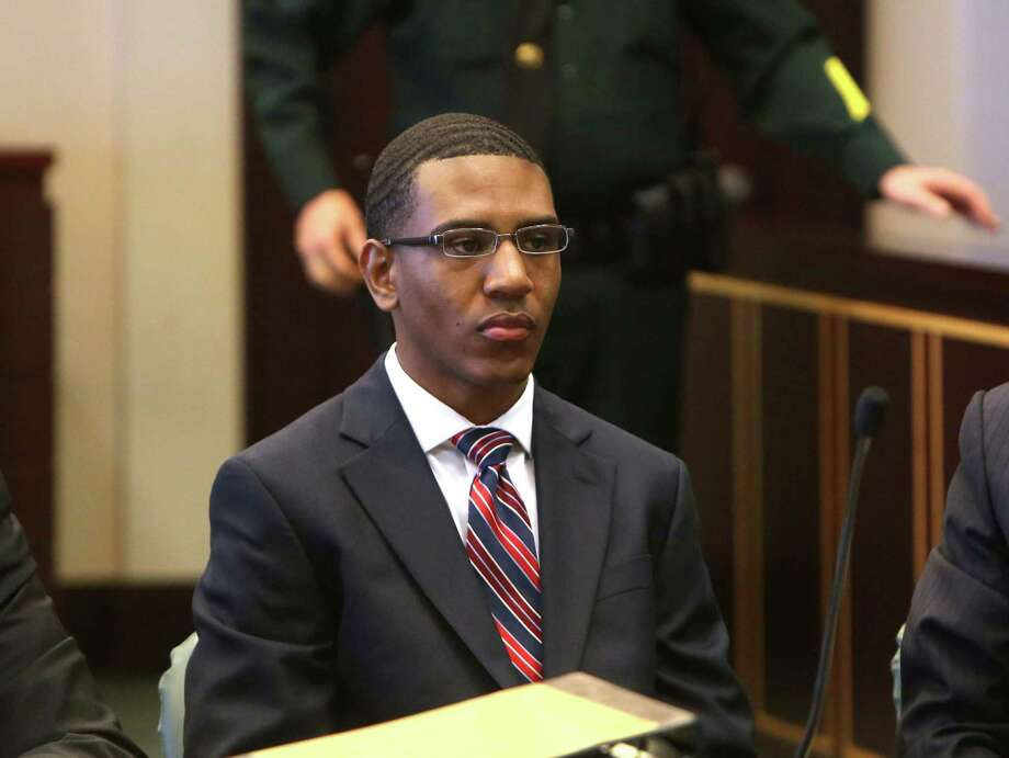 Dante Martin waits during jury selection for his manslaughter trial in Orlando, Fla., Oct. 27, 2014. Nearly three years after Florida A&M University marching band drum major Robert Champion was pummeled to death on a bus in a chilling hazing ritual, Martin, a former marching band member portrayed by prosecutors as the ring leader, faced a jury on Tuesday on charges of manslaughter. (George Skene/Pool via The New York Times) -- FOR EDITORIAL USE ONLY. -- Photo: GEORGE SKENE, POOL / POOL