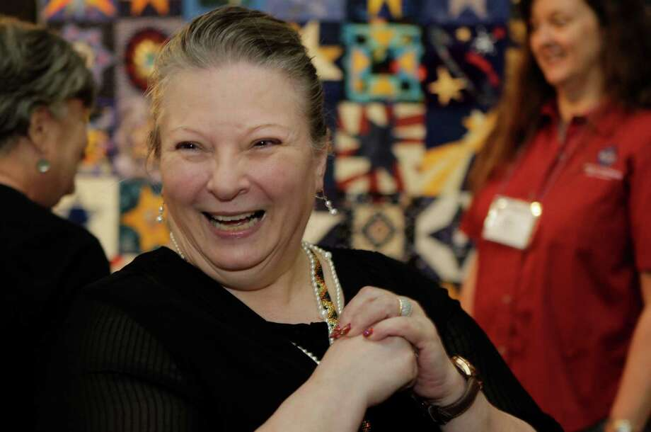 "Vicki Mangum is a fixture at the International Quilt Festival at the George R. Brown Convention Center. She's worked for 18 years on a quilt named ""Tulip Basket."" Photo: Melissa Phillip, Staff / © 2014  Houston Chronicle"