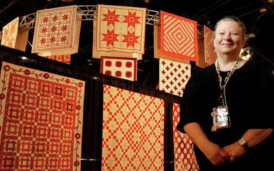 Vicki Mangum is shown at the Ruby Jubilee exhibit that celebrates the 40th anniversary of the International Quilt Festival at the George R. Brown Convention Center on Oct. 31, 2014. Photo: Melissa Phillip, Staff / © 2014  Houston Chronicle