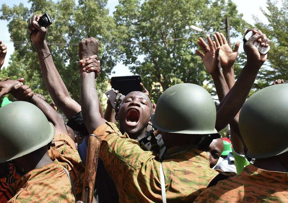 Protesters in front of army headquarters in Burkina Faso's capital of Ouagadougou urge the army to take control of the country after the resignation of President Blaise Compaore. Photo: ISSOUF SANOGO, Staff / AFP