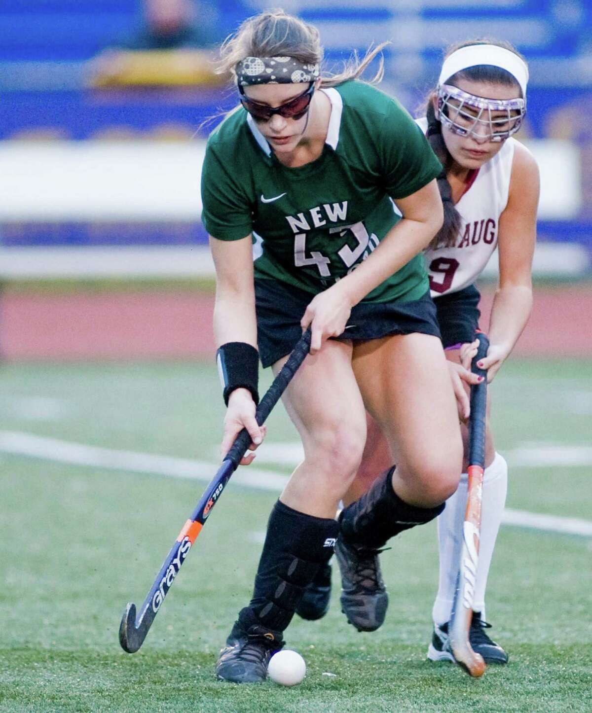 Natalie Capriglione of New Milford High School blocks out Joanna Rizza of Pomperaug High School during the SWC field hockey championship at Brookfield High School. Friday, Oct. 31, 2014