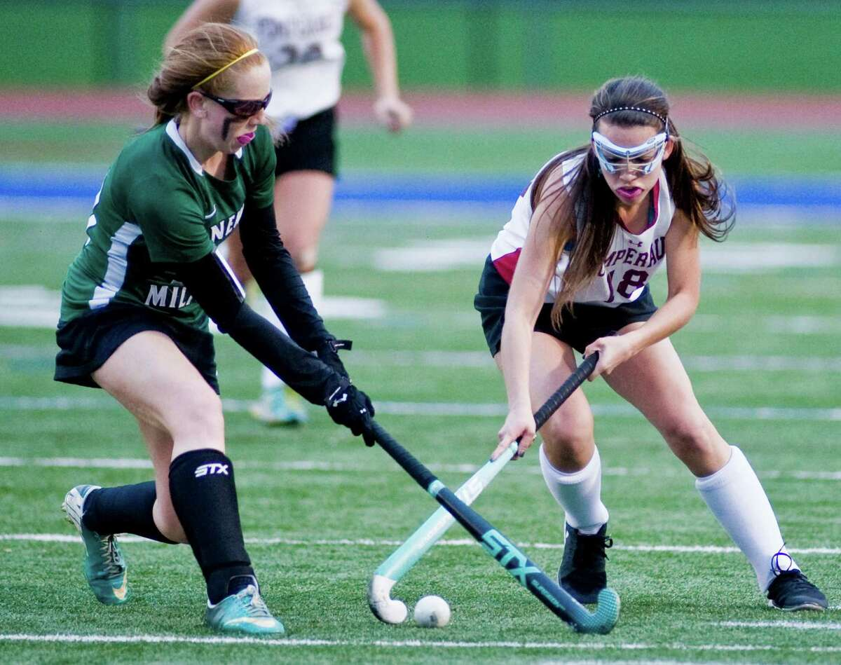 Allison Noteware of New Milford High School and Bernadette Sherwood of Pomperaug High School fight for the loose ball during the SWC field hockey championship at Brookfield High School. Friday, Oct. 31, 2014