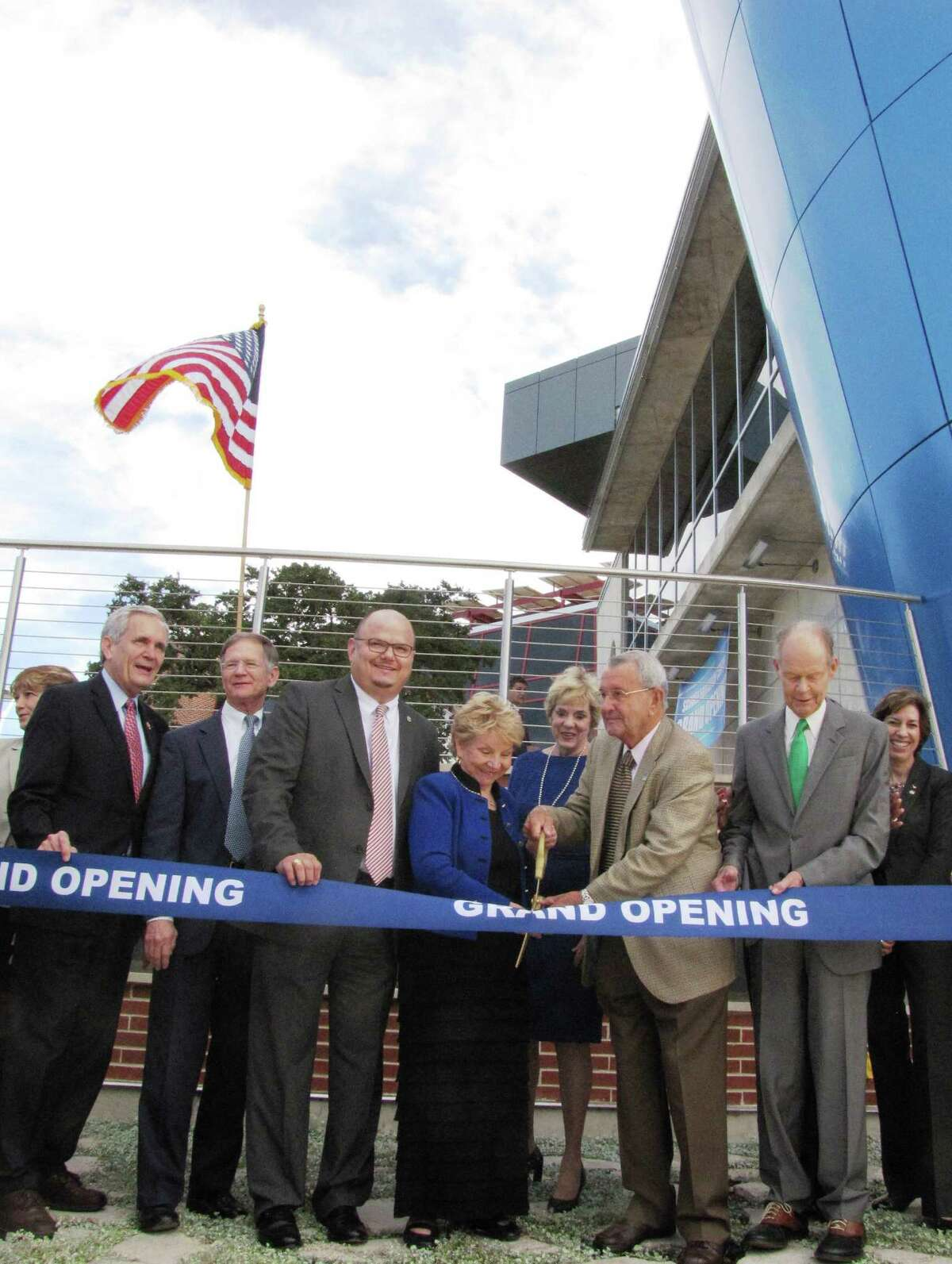 """Dignitaries join June Scobee Rodgers (center) in cutting the ribbon to San Antonio College's new Scobee Education Center at the facility's grand opening Friday, Oct. 31. Rodgers is the widow of Francis """"Dick"""" Scobee, one of seven who died in the 1986 Challenger shuttle explosion."""