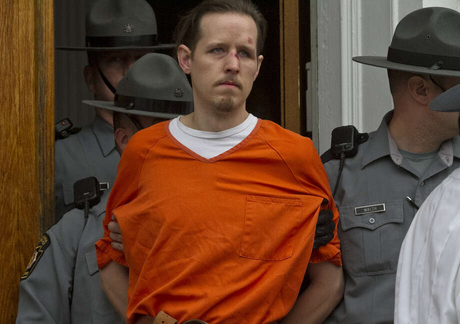 Eric Frein was arraigned on first-degree murder and other charges in the killing of Cpl. Byron Dickson and the wounding of Trooper Alex Douglass. Photo: Michael J. Mullen / Associated Press / The Scranton Times-Tribune