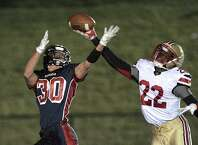 Stratford's Fred Clark (22) reaches up to knock away a pass in tended for New Fairfield's Gregory Radovic (30) during the football game between Stratford High School and New fairfield High School, on Friday, October 31, 2014, in New Fairfield, Conn.