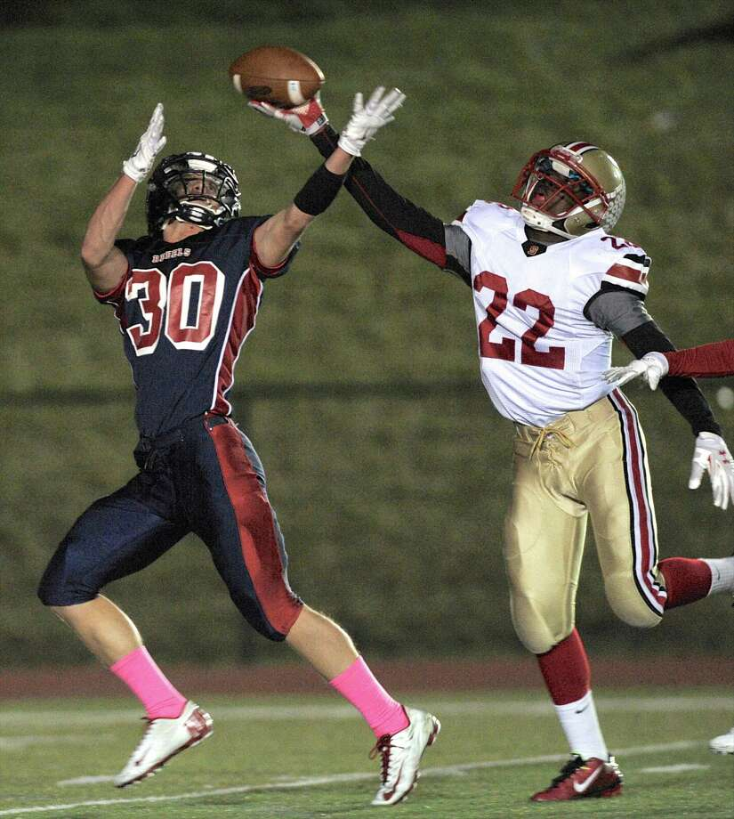 Stratford's Fred Clark (22) reaches up to knock away a pass in tended for New Fairfield's Gregory Radovic (30) during the football game between Stratford High School and New fairfield High School, on Friday, October 31, 2014, in New Fairfield, Conn. Photo: H John Voorhees III / The News-Times