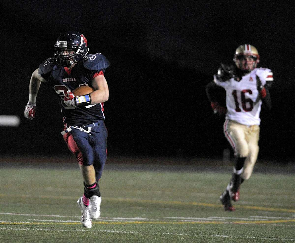 New Fairfield's James Lewis (34) is chased by Stratford's Stephen Rohaly (16) on his way to scoring a touchdown during a football game between Stratford High School and New Fairfield High School, on Friday, October 31, 2014, in New Fairfield, Conn.