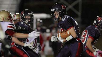 New Fairfield's Gregory Radovis (30)cuts towards the line during the  football game between Stratford High School and New Fairfield High School, on Friday, October 31, 2014, in New Fairfield, Conn.