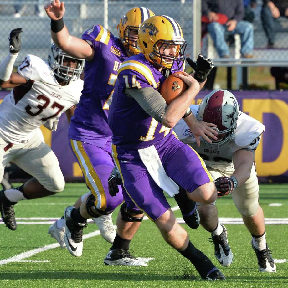 UAlbany quarterback Will Fiacchi runs the ball during Saturday's game against Colgate at Bob Ford Field  Oct. 25, 2014, in Albany, NY.  (John Carl D'Annibale / Times Union) Photo: John Carl D'Annibale / 00029094A