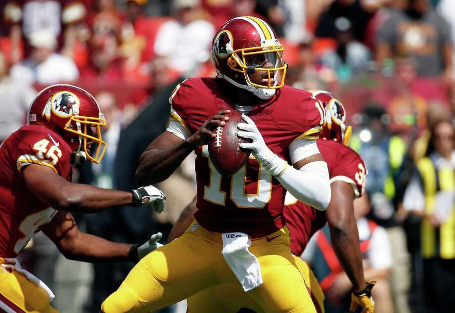FILE - In this Sept. 14, 2014 file photo, Washington Redskins quarterback Robert Griffin III (10) looks to pass during the first half of an NFL football game against the Jacksonville Jaguars in Landover, Md. After six-plus games on the sideline, Robert Griffin III is back as the quarterback of the Washington Redskins for Sunday's, Nov. 2, 2014 game at Minnesota. (AP Photo/Alex Brandon, File) ORG XMIT: NY169 Photo: Alex Brandon / AP