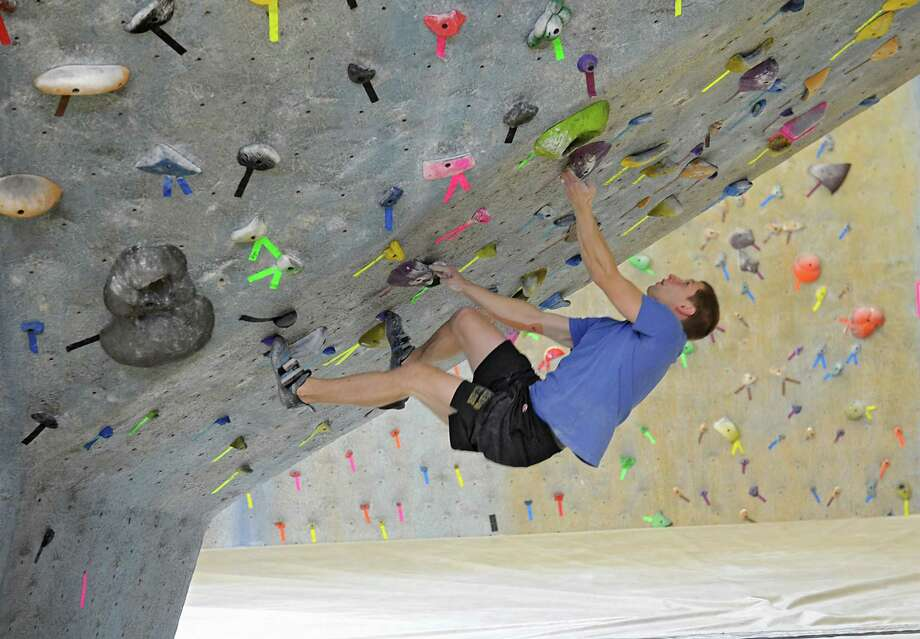 Taylor Treadgold, 22, of Altamont,  enjoys climbing at The Edge of Halfmoon, an Indoor rock climbing facility on Friday, Oct. 31, 2014 in Albany, N.Y. The center also has a gym, high ropes course, cafe, basketball courts and volleyball courts. Today Christi's Light of Mine Cafe at this recreation center was officially dedicated to the memory of Chris Richmond with a ribbon cutting ceremony. (Lori Van Buren / Times Union) Photo: Lori Van Buren / 00029274A