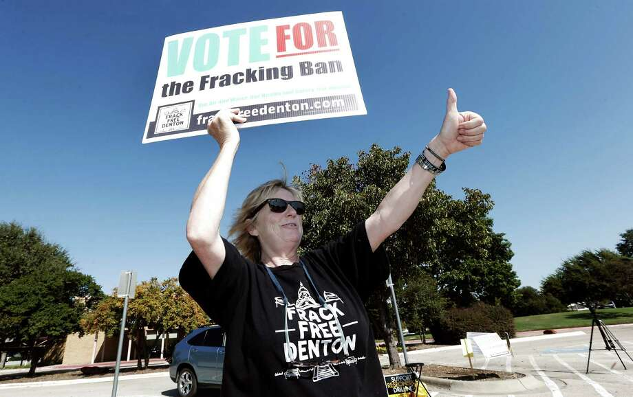 Anti-fracking advocate Cathy McMullen gives a thumbs up to passing motorist at the Denton Civic Center. Photo: Brandon Wade, STR / Brandon Wade