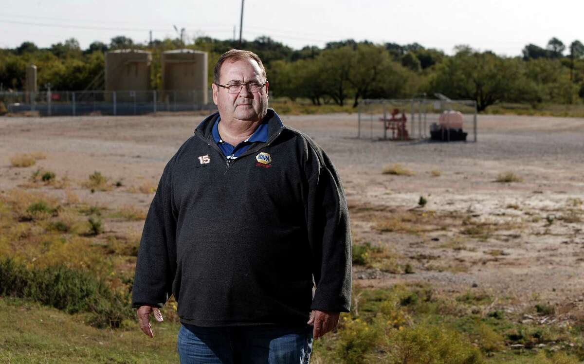 Treasurer of Denton Taxpayers for a Strong Economy Bobby Jones poses for a portrait in front of a well head that sits approximately 300 feet from his house in Denton, Thursday, Oct. 30, 2014. The group opposes banning fracking in Denton. Special to the Houston Chronicle/Brandon Wade