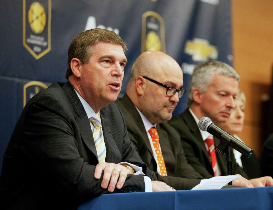 FILE - In this April 4, 2014, file photo, University of Michigan Director of Athletics Dave Brandon, left, speaks to the media during a news conference in Ann Arbor, Mich. Others are unidentified. Brandon has resigned, setting the stage for new leadership at the top of one of the nation's most prominent athletic departments.  (AP Photo/The Ann Arbor News, Patrick Record, File)  LOCAL TELEVISION OUT; LOCAL INTERNET OUT Photo: Patrick Record, MBI / The Ann Arbor News
