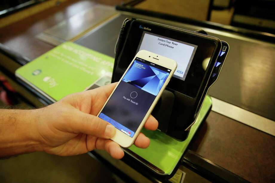 The Apple Pay mobile payment system is demonstrated at a Whole Foods store in Cupertino, Calif. Apple has some advantages that other entrants into the mobile payment space have not — including joining the market at a time when consumers have heightened concerns about credit card security, following a rash of payment data breaches this year. Photo: Associated Press File Photo / AP