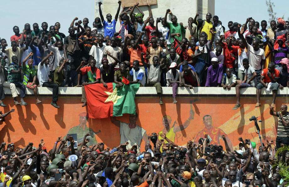 Burkinese celebrate in Ouagadougou after embattled President Blaise Compaoré announced he was stepping down. Photo: Issouf Sanogo / AFP / Getty Images / AFP