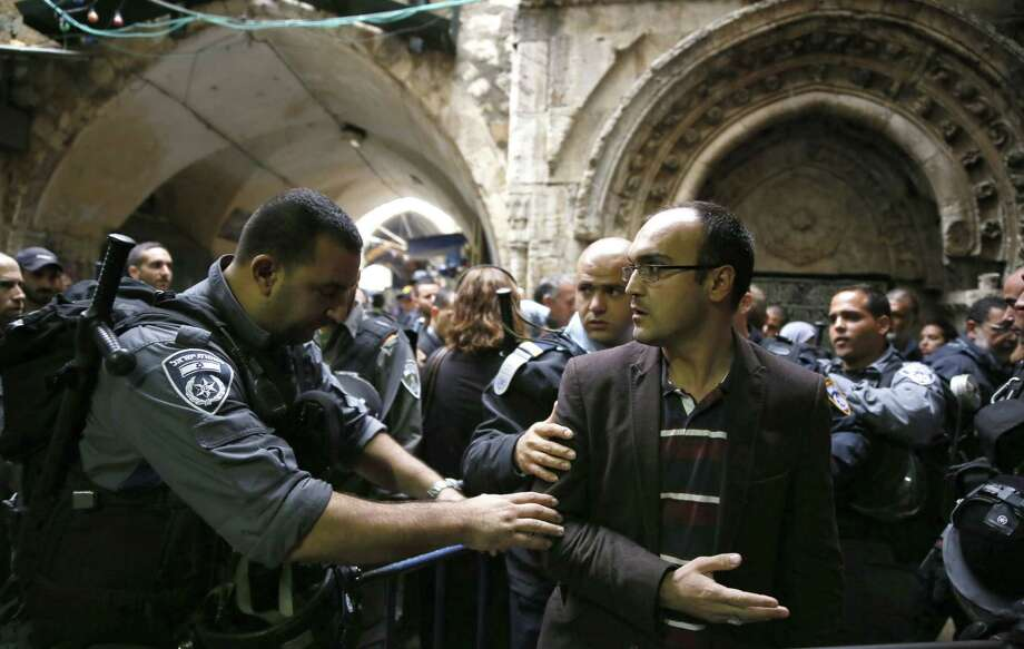 Israeli anti-riot police prevent a Palestinian man under the age of 50 to enter  Al-Aqsa mosque compound for the Friday prayer. The site's been a contentious one between Jews and Muslims. Photo: Gali Tibbon / Getty Images / AFP
