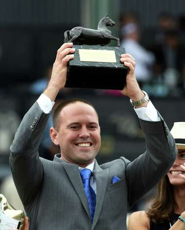 Mechanicville native Chad Brown holds the winner's trophy aloft after his charge Lady Eli won the Breeders' Cup Juvenile Fillies Turf Friday evening Oct. 31, 2014 at Santa Anita Race Track in Arcadia, California     (Skip Dickstein/Times Union) Photo: SKIP DICKSTEIN