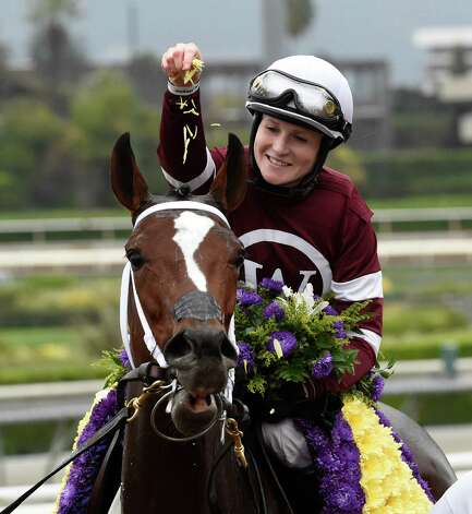Jockey Rosie Napravnik puts petals from the winner's garland on Untapable after winning the 31st running of the Breeders' Cup Distaff  Friday evening Oct. 31, 2014 at Santa Anita Race Track in Arcadia, California     (Skip Dickstein/Times Union) Photo: SKIP DICKSTEIN