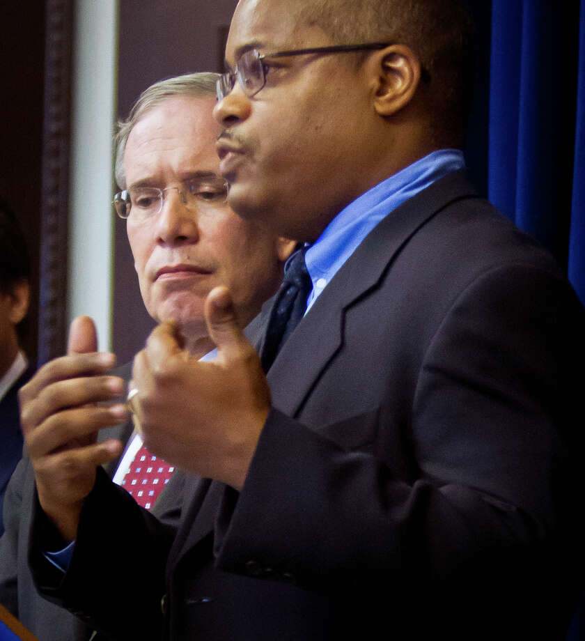 New York Comptroller Scott Stringer, left, listens as Derek Sells, lawyer for the estate of Jerome Murdough, speaks at a press conference after Stringer announced a $2.25 million settlement with the estate Friday Oct. 31, 2014, in New York. Jerome Murdough, 56, died in a mental observation unit on Rikers Island jail on Feb. 15, eight days after he was sent to the facility because he couldn't afford to pay $2,500 bail on a trespassing arrest. (AP Photo/Bebeto Matthews) ORG XMIT: NYBM103 Photo: Bebeto Matthews / AP