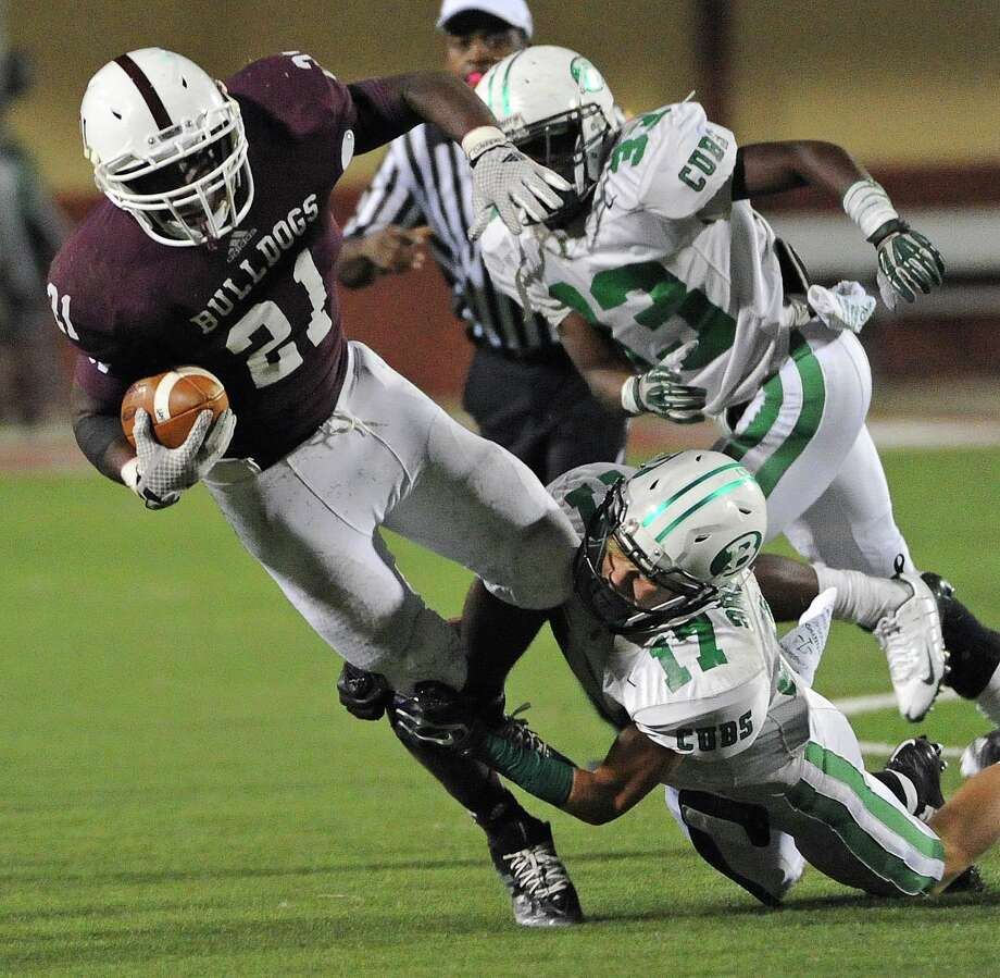Waller running back Derrick Wright (21) is tackled by Brenham cornerback Jonathan Homan during the first half of a high school football game, Friday, October 31, 2014, at Waller ISD Stadium in Waller. Photo: Eric Christian Smith, For The Chronicle / 2014 Eric Christian Smith