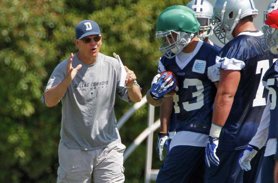 ADVANFE FOR WEEKEND EDITIONS, NOV. 1-2 - FILE - In this May 16, 2014, file photo, Dallas Cowboys defensive coordinator Rod Marinelli instructs players during a rookie minicamp at the Cowboys' headquarters in Irving, Texas. Marinelli loved his 0-16 season when he was the head coach in Detroit. He loved last season as one of the architects of the league's worst defense in Dallas. Why? How? Because he's a football lifer who immerses himself in the daily grind of building players, regardless of circumstances. And now the Cowboys are enjoying the fruits of his optimism with a surprising defense on a team that has far exceeded expectations, at least to this point and despite a bump in road a week ago against Washington.  (AP Photo/Tim Sharp, File) Photo: TIM SHARP, FRE / Associated Press / FR62992 AP