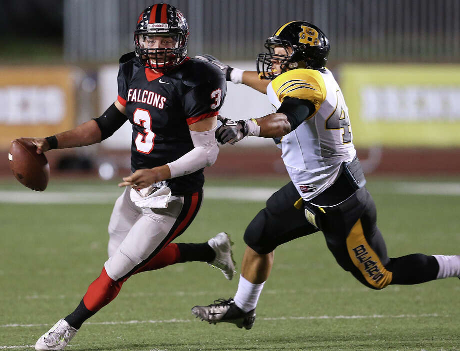 Falcon quarterback Bobby Chacon is pressured by the Bears' Troy Irby as Brennan plays Stevens at Gustafson Stadium on October 31, 2014. Photo: TOM REEL