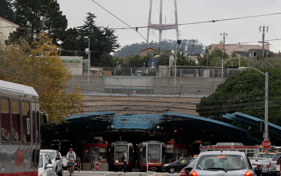 Muni trolleys travel in and out of the West Portal Station, which tunnels under Twin Peaks. Photo: Daniel E. Porter / The Chronicle / ONLINE_YES