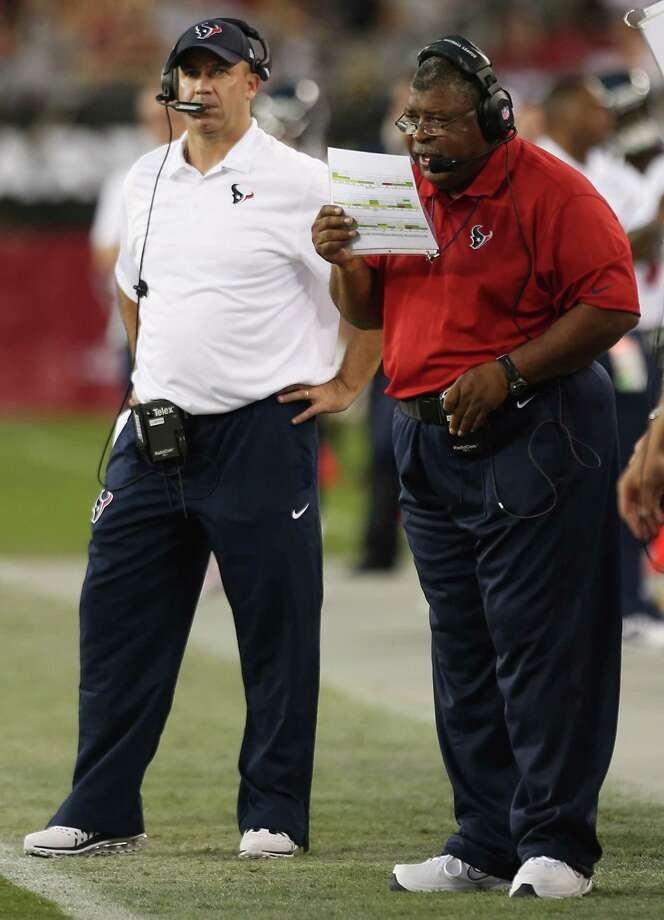 Coach Bill O'Brien, left, and defensive coordinator Romeo Crennel have been putting their heads together in order to figure how to combat the Eagles' offense. Photo: Brett Coomer, Staff / © 2014  Houston Chronicle