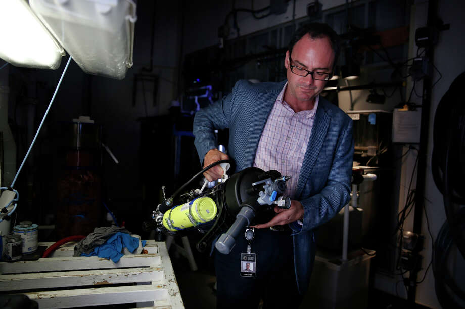 Bart Shepherd, director of the Steinhart Aquarium, holds a pressure chamber used to bring up deep sea fish at the California Academy of Sciences in San Francisco. Photo: Lea Suzuki / The Chronicle / ONLINE_YES
