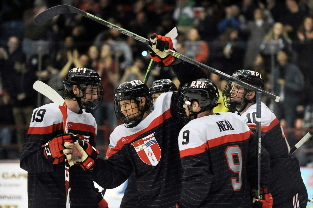 RPI's Viktor Liljegren, center, celebrates his second period goal during their hockey game against Union on Friday, Oct. 31, 2014, at Rensselaer Polytechnic Institute in Troy, N.Y. (Cindy Schultz / Times Union)