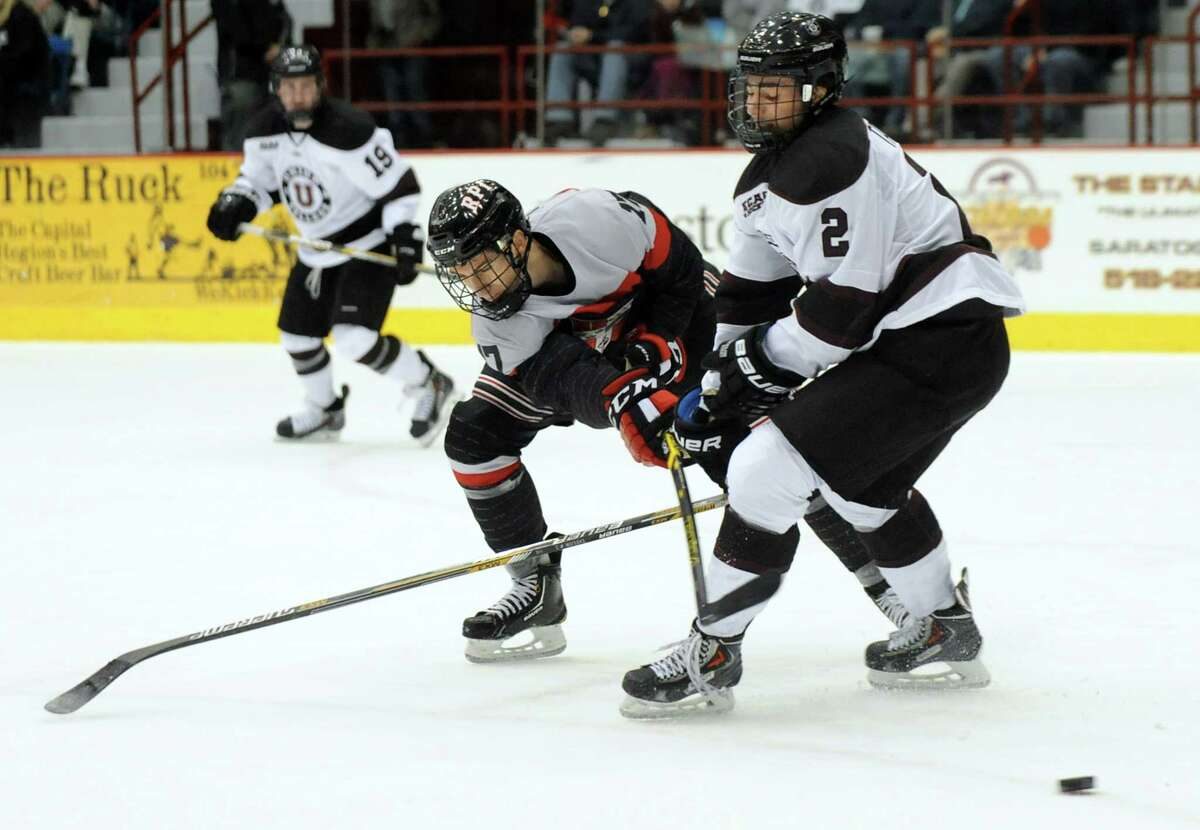 RPI's Milos Bubela, center, struggles with Union's Jeff Taylor in front of the net during their hockey game against Union on Friday, Oct. 31, 2014, at Rensselaer Polytechnic Institute in Troy, N.Y. (Cindy Schultz / Times Union)