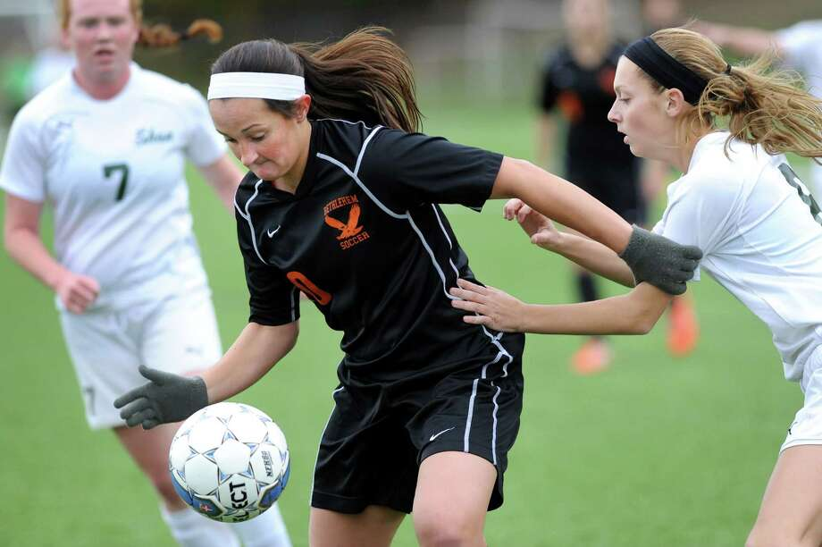 Bethlehem's Kaylee Rickert, center, controls the ball during their Class AA girls' soccer semifinal game against Shenendehowa on Friday, Oct. 31, 2014, at Lansingburgh High in Troy, N.Y. (Cindy Schultz / Times Union) Photo: Cindy Schultz / 00029252A