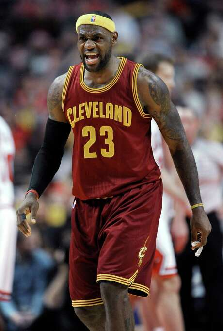 Cleveland Cavaliers' LeBron James yells to teammate Kevin Love after James scored on an assist from Love during overtime in an NBA basketball game against the Chicago Bulls in Chicago, Friday, Oct. 31, 2014. Cleveland won 114-108. (AP Photo/Paul Beaty) Photo: PAUL BEATY, FRE / FR36811 AP