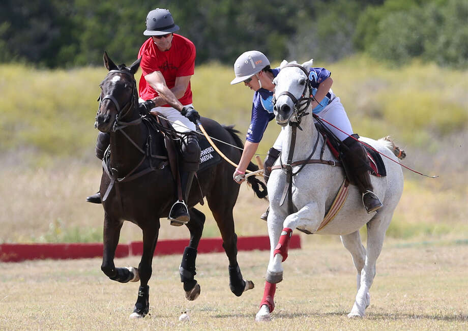 Kike Garcia (right) and Gal Shweiki fight for a ball during a San Antonio Polo Club practice game at their practice field in Bulverde. Polo in the Park play unfolds Sunday afternoon. Photo: Marvin Pfeiffer / San Antonio Express-News / EN Communities 2014