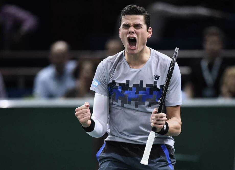 Canada's Milos Raonic celebrates his victory over  Switzerland's Roger Federer  - his first in seven tries - in Friday's quarterfinals of the Paris Masters. Photo: FRANCK FIFE, Staff / AFP