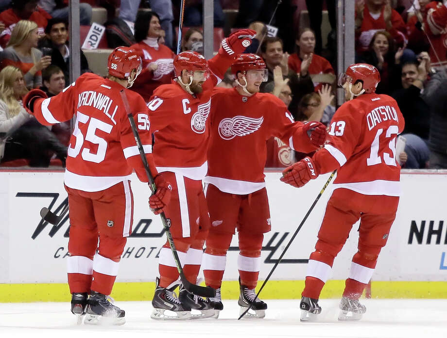 Detroit Red Wings' Gustav Nyquist (14), of Sweden, second from right, celebrates his first period goal against the Los Angeles Kings with teammates Niklas Kronwall (55), of Sweden, Henrik Zetterberg, of Sweden, and Pavel Datsyuk (13), of Russia, during an NHL hockey games Friday, Oct. 31, 2014, in Detroit. (AP Photo/Duane Burleson) ORG XMIT: DTA101 Photo: Duane Burleson / FR38952 AP