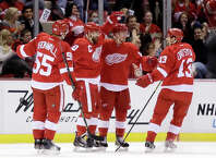 Detroit Red Wings' Gustav Nyquist (14), of Sweden, second from right, celebrates his first period goal against the Los Angeles Kings with teammates Niklas Kronwall (55), of Sweden, Henrik Zetterberg, of Sweden, and Pavel Datsyuk (13), of Russia, during an NHL hockey games Friday, Oct. 31, 2014, in Detroit. (AP Photo/Duane Burleson) ORG XMIT: DTA101
