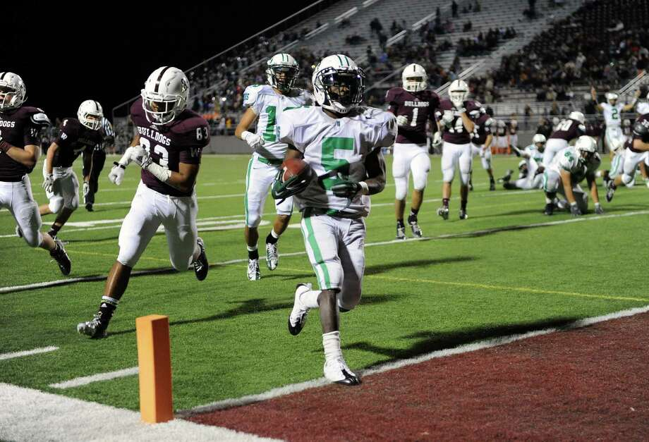 The end zone became a familiar destination for Brenham running back Earnest Patterson (5) on Friday night in Bulldog Stadium. He ran for four touchdowns, covering 3, 6, 10 and 11 yards. Photo: Eric Christian Smith, Freelance / 2014 Eric Christian Smith