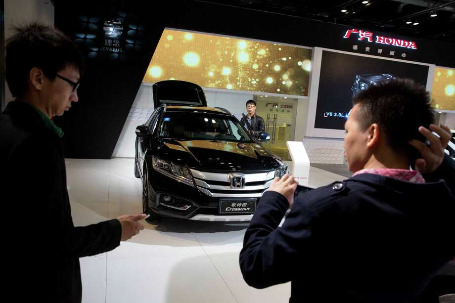 Visitors to the 2014 Energy Saving and New Energy Car Expo last month in Beijing got to see an SUV on display. Analysts expect China to be the biggest market for sport utility vehicles in the world by 2018. Photo: Ng Han Guan, STF / AP
