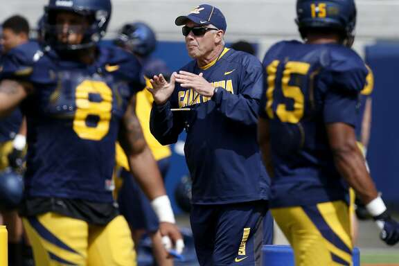 New defensive coordinator, Art Kaufman worked with his defense at a recent practice Tuesday August 12, 2014. The Cal football program is in training camp mode at Memorial Stadium as they prepare for the upcoming season.