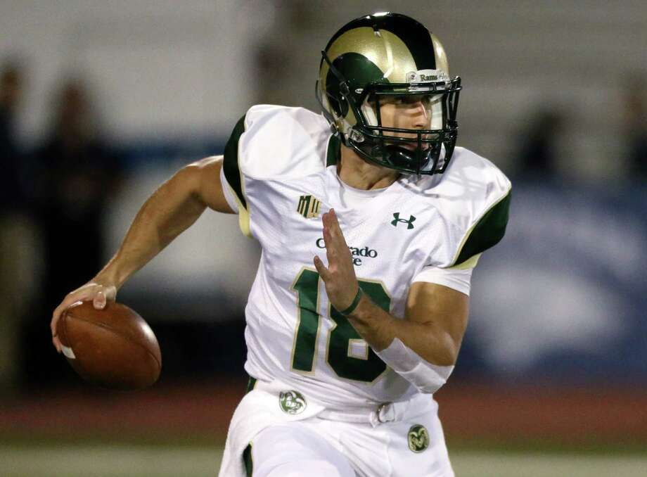 Colorado's State quarterback Garrett Grayson (18) runs in the second half of an NCAA college football game against Nevada, in Reno, Nev., on Saturday, Oct. 11, 2014. Colorado State defeated Nevada 31-24. (AP Photo/Cathleen Allison) Photo: Cathleen Allison / Associated Press / FR70203 AP