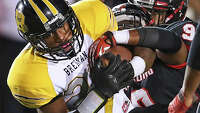 Warren's 2 TDs spark Bears - Photo