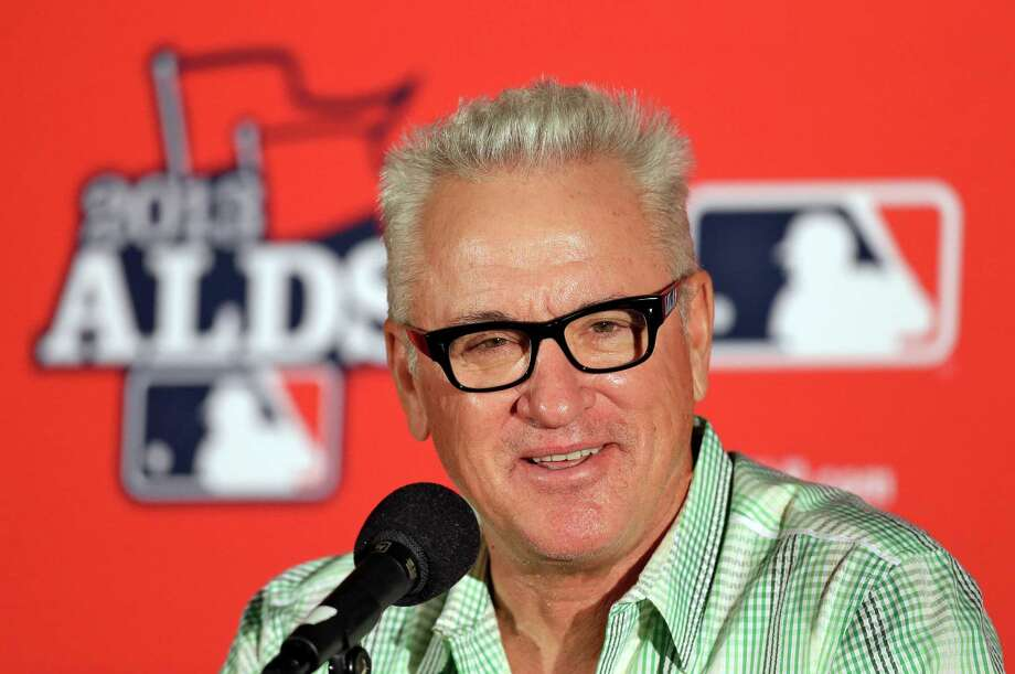 FILE - In this Oct. 6, 2013, file photo, Tampa Bay Rays manager Joe Maddon smiles during a news conference before Game 3 of baseball's American League division series against the Boston Red Sox in St. Petersburg, Fla. The Chicago Cubs have fired manager Rick Renteria after one season to pursue former Tampa Bay manager Joe Maddon. Team President Theo Epstein said Friday, Oct. 31, 2014,  that Renteria deserved to come back next season as the Cubs continue their rebuilding effort. But Maddon opted out of his contract with the Rays and Epstein says that changed things for the Cubs.(AP Photo/Chris O'Meara, File) Photo: Chris O'Meara / Associated Press / AP