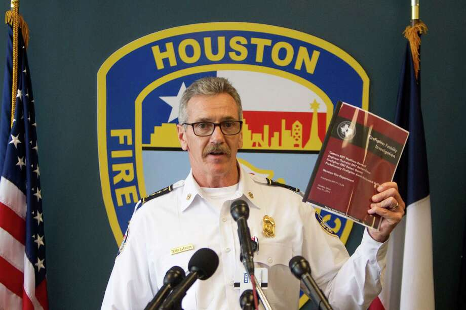 Houston Fire Chief Terry Garrison holds a copy of the completed Texas State Fire Marshal's Office investigation into the May 31, 2013 SW Inn fire that claimed the lives of four Houston Firefighters, at HFD headquarters, Friday, Oct. 31, 2014, in Houston. Photo: Cody Duty, Houston Chronicle / © 2014 Houston Chronicle