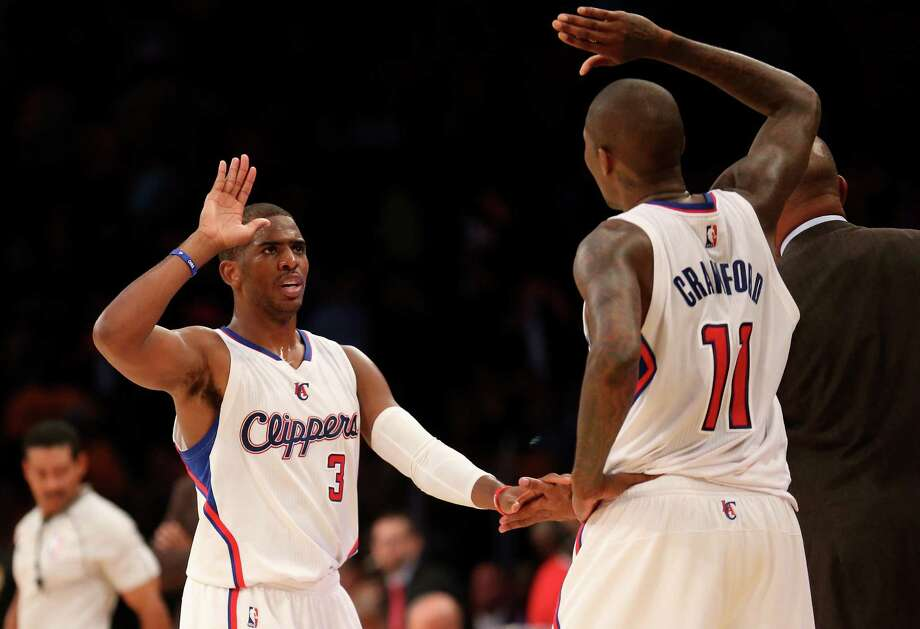 LOS ANGELES, CA - OCTOBER 31:  Chris Paul #3 and Jamal Crawford #11 of the Los Angeles Clippers celebrate in the final minute of the game against the Los Angeles Lakers at Staples Center on October 31, 2014 in Los Angeles, California. The Clippers won 118-111.  NOTE TO USER: User expressly acknowledges and agrees that, by downloading and or using this photograph, User is consenting to the terms and conditions of the Getty Images License Agreement.  (Photo by Stephen Dunn/Getty Images) Photo: Stephen Dunn / Getty Images / 2014 Getty Images