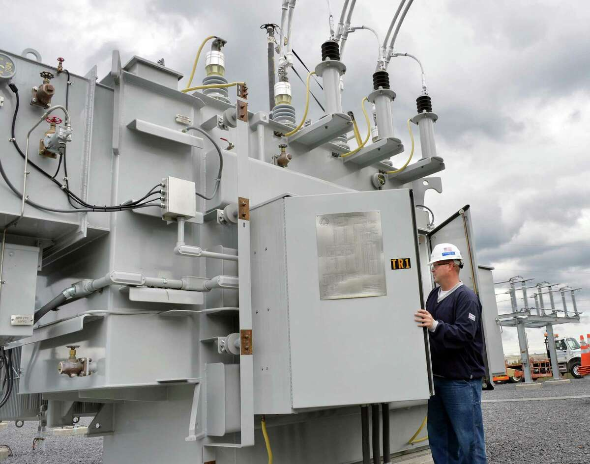 Relay tester Bryan Simonik commission tests a new 25 MVA transformer at National Grid's new substation rebuilt after Superstorm Sandy Tuesday, Oct. 7, 2014, in Amsterdam, N.Y. (John Carl D'Annibale / Times Union)