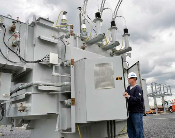 Relay tester Bryan Simonik commission tests a new 25 MVA transformer at National Grid's new substation rebuilt after Superstorm Sandy Tuesday, Oct. 7, 2014, in Amsterdam, N.Y.  (John Carl D'Annibale / Times Union) Photo: John Carl D'Annibale / 10028907A