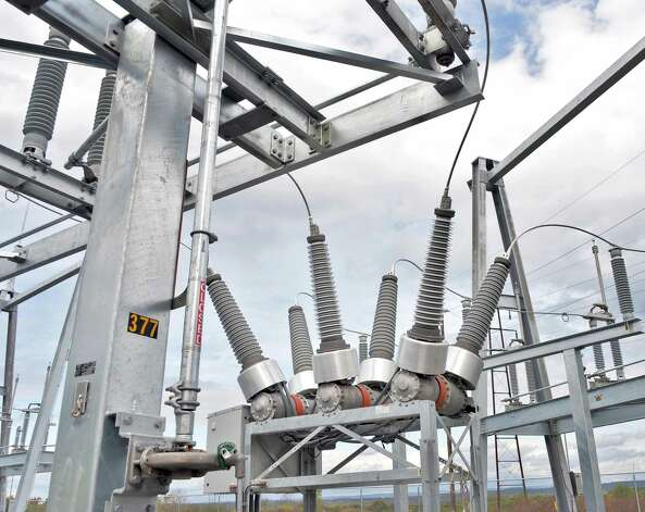 A new 69,000 volt vacuum circuit breaker, center, at National Grid's new substation rebuilt after superstorm sandy Tuesday, Oct. 7, 2014, in Amsterdam, N.Y.  (John Carl D'Annibale / Times Union) Photo: John Carl D'Annibale / 10028907A